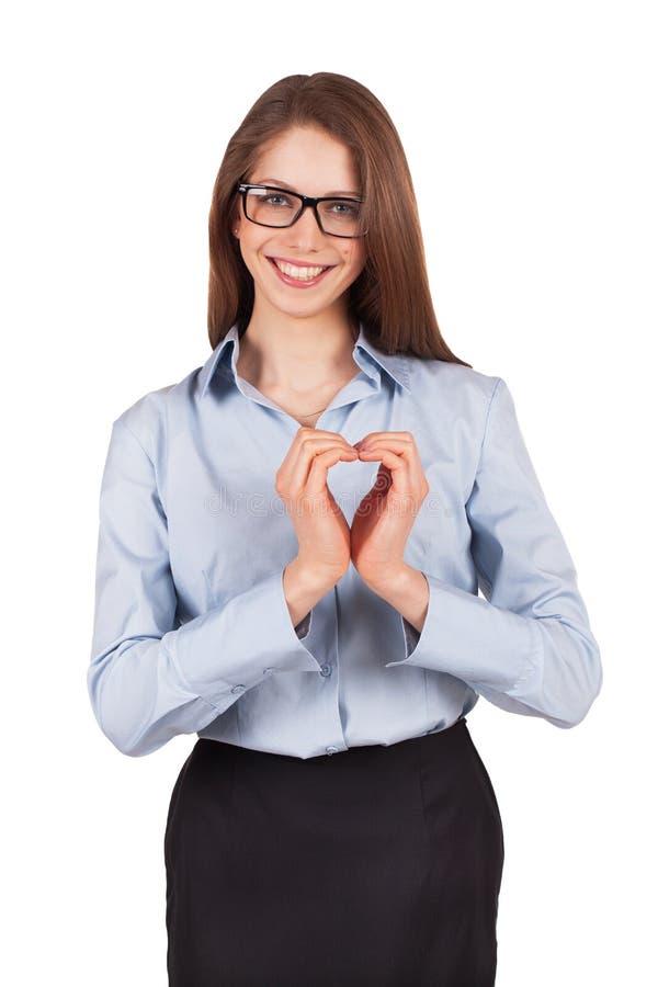 Szczęśliwa kobieta stawia jej ręki w postaci serca fotografia royalty free