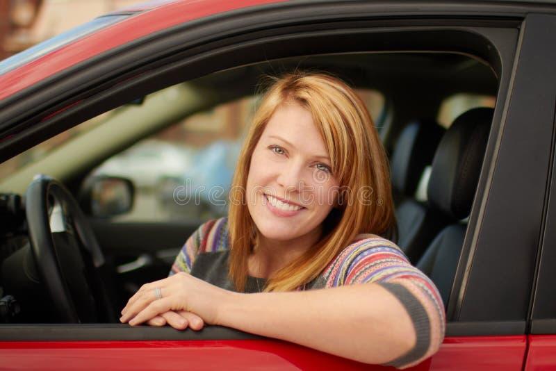 Kobieta w samochodzie obrazy stock