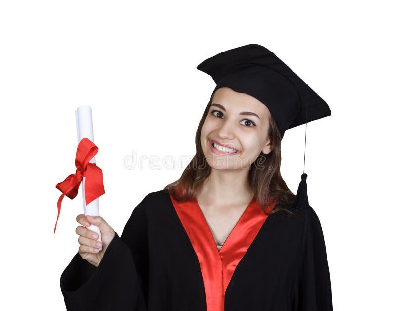 Szczęśliwa młoda kobieta w skalowanie todze pokazuje dyplom zdjęcia royalty free