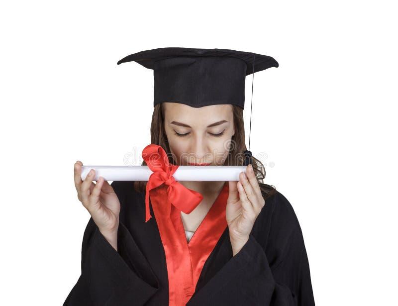 Szczęśliwa młoda kobieta w skalowanie togi buziaka dyplomu obraz royalty free