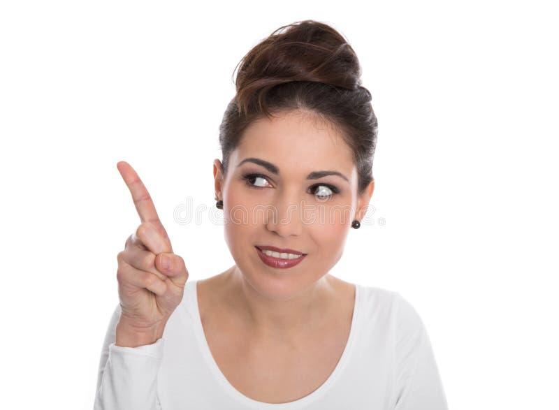 Szczęśliwa młoda kobieta wskazuje z forefinger odizolowywającym na bielu. fotografia royalty free