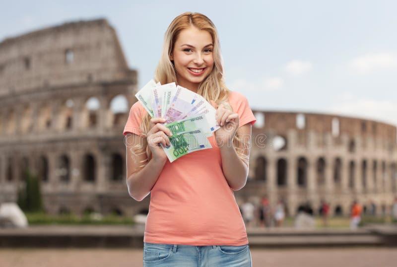Szczęśliwa młoda kobieta z euro gotówki pieniądze fotografia stock