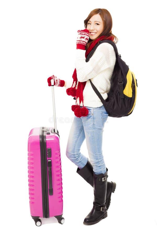 Szczęśliwa młoda piękna kobieta trzyma bagaż i plecaka obraz royalty free