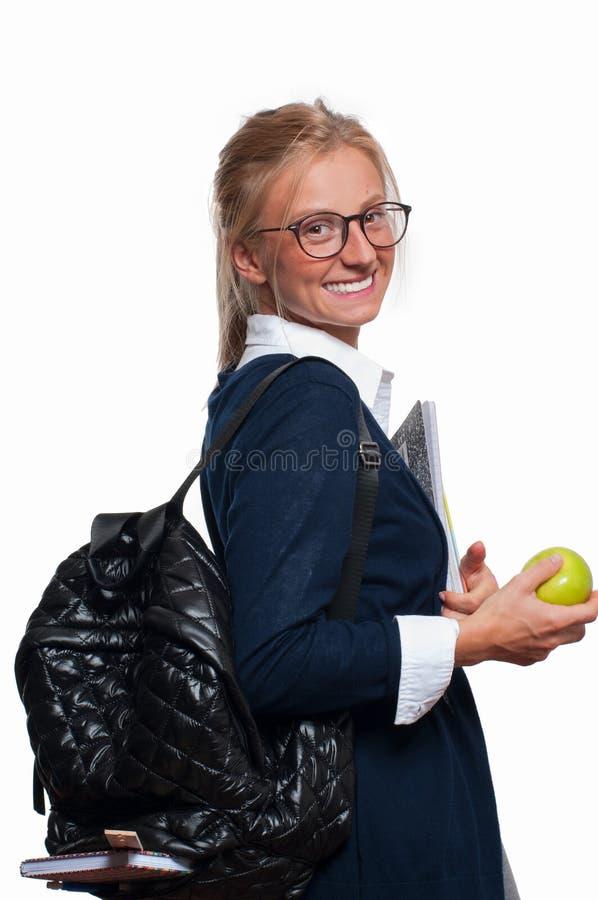 Szczęśliwa młoda studencka dziewczyna z plecakiem tylna szkoły obrazy royalty free