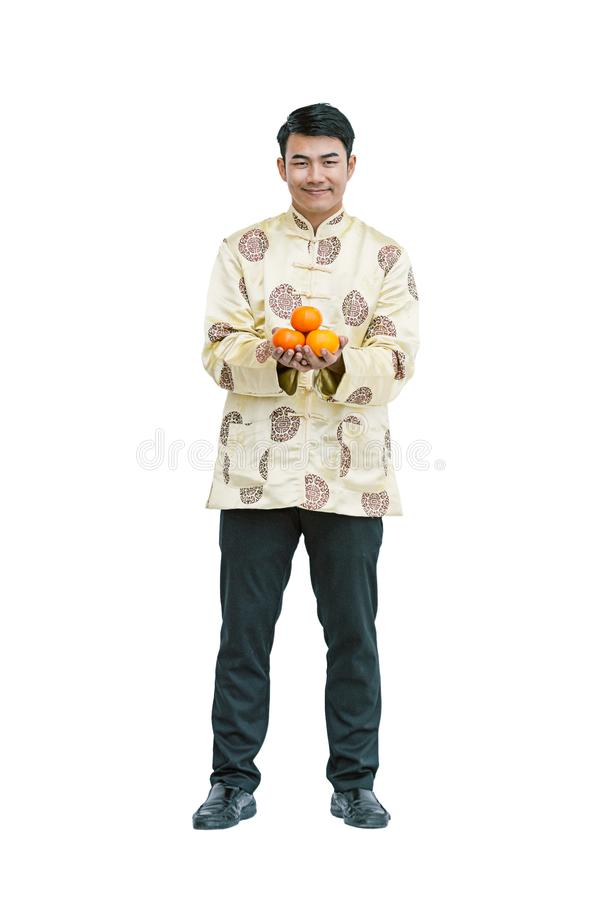 Szczęśliwa młodego człowieka mienia pomarańcze chiński nowy rok zdjęcia royalty free