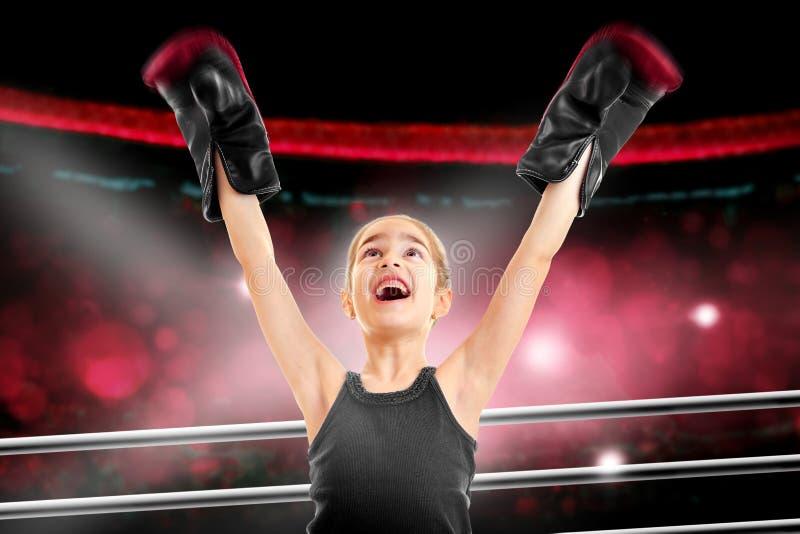 Szczęśliwa mała dziewczynka boksera wygrana walka fotografia royalty free