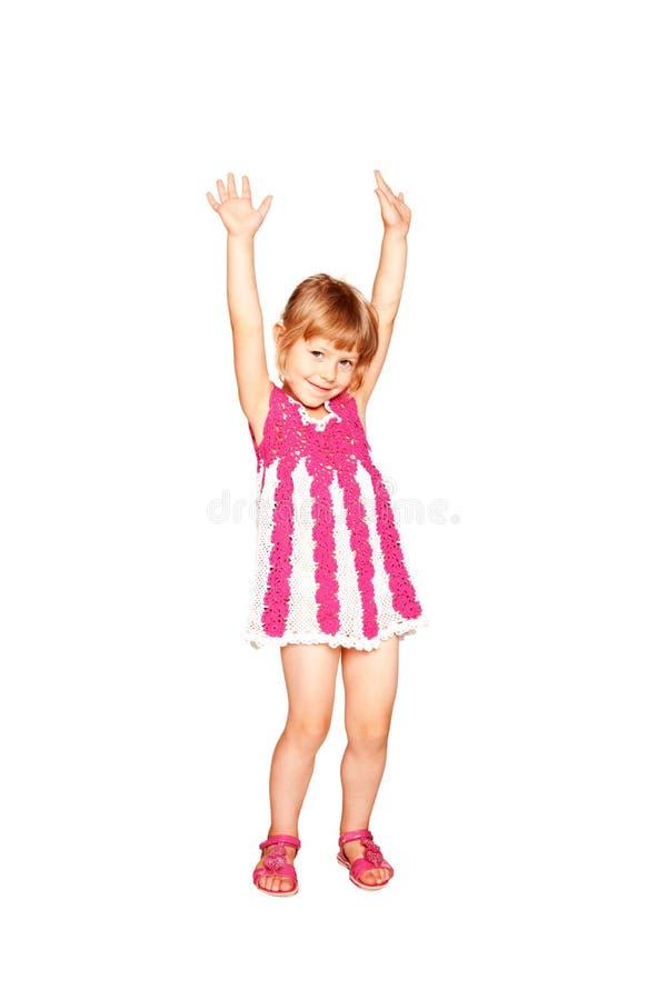 Szczęśliwa mała dziewczynka w trykotowym smokingowym tanu zdjęcie royalty free