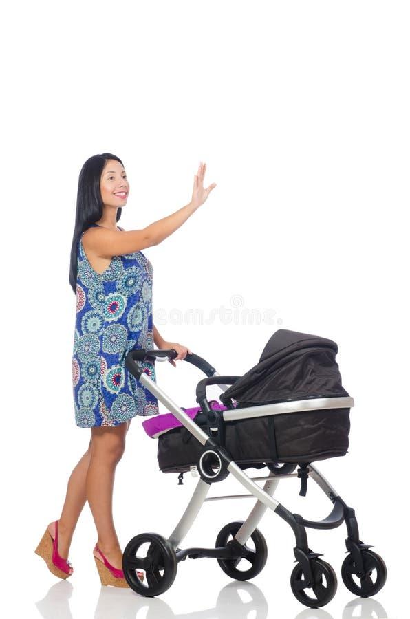 Szczęśliwa mama z jej dzieckiem w pram obraz royalty free