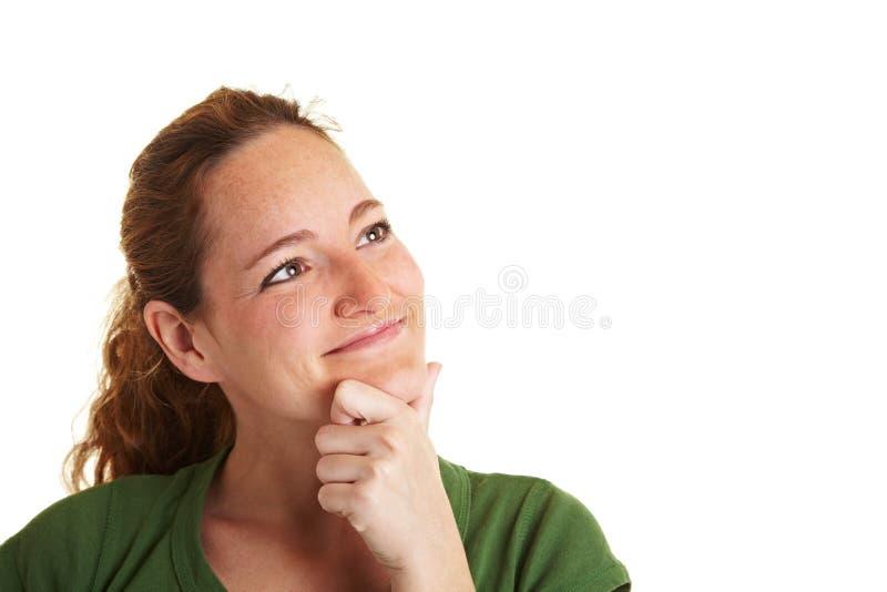 szczęśliwa myśląca kobieta obrazy stock