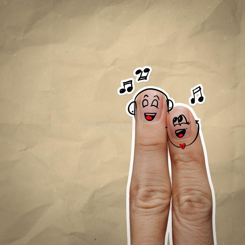 Szczęśliwa palcowa para w miłości z malującym smiley i śpiewa s zdjęcie royalty free