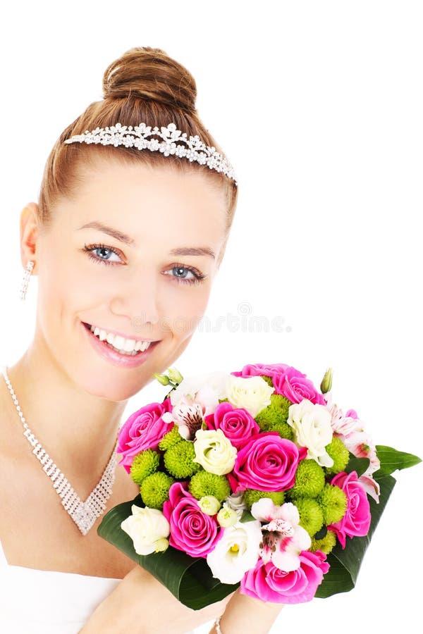 Szczęśliwa panna młoda z kwiatami obrazy royalty free