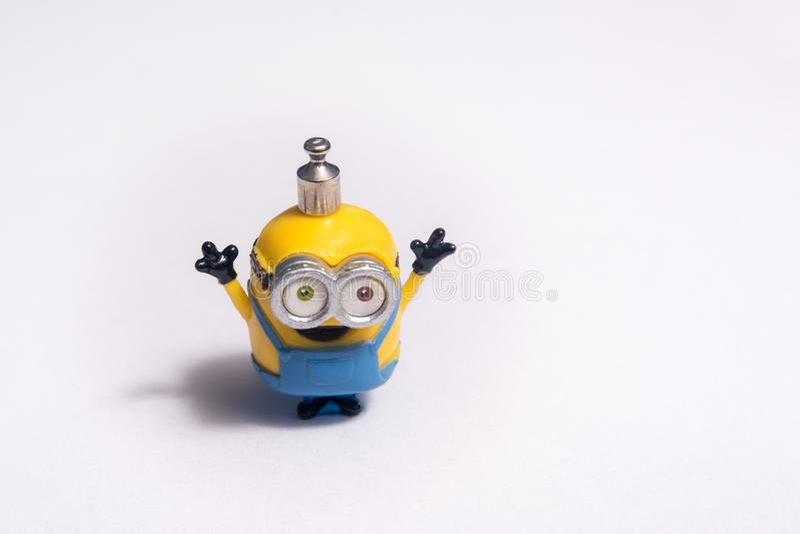 Szczęśliwa podła kolonel zabawka z małym ciężarem na jego głowie fotografia stock