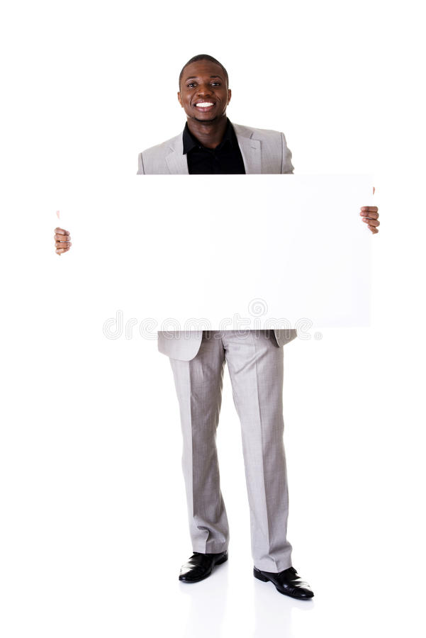 Szczęśliwa pomyślna biznesmena mienia pustego miejsca reklama. zdjęcia royalty free
