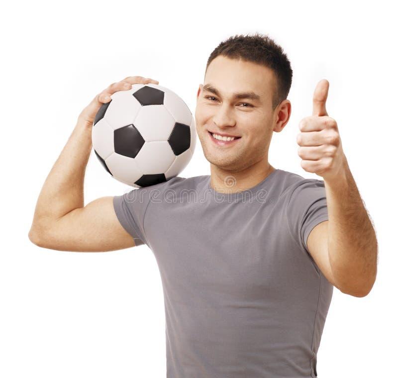 Szczęśliwa przystojna mienie piłki nożnej piłka obrazy royalty free