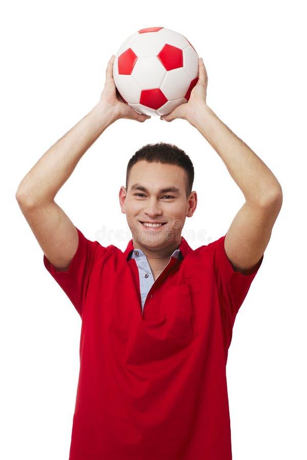 Szczęśliwa przystojna mienie piłki nożnej piłka obrazy stock