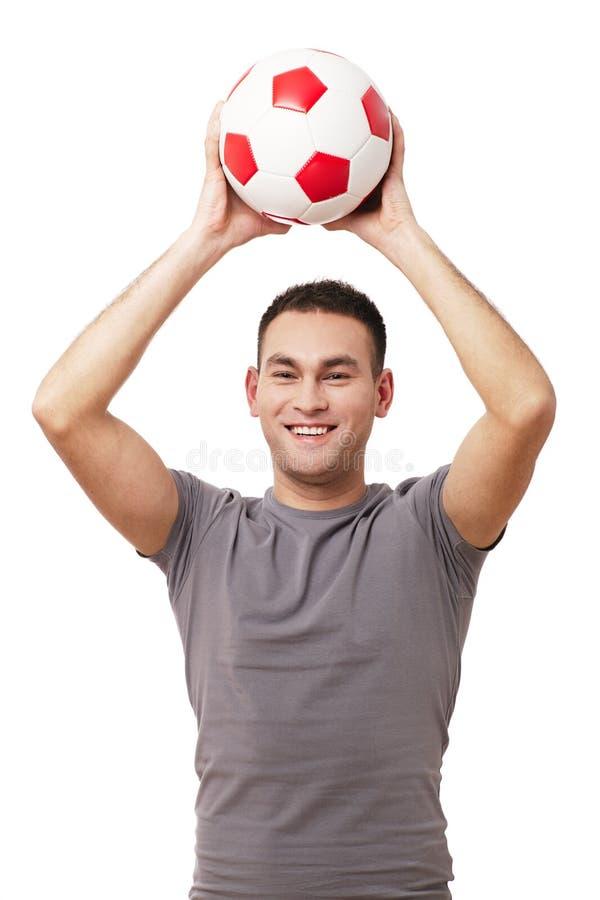 Szczęśliwa przystojna mienie piłki nożnej piłka zdjęcia royalty free
