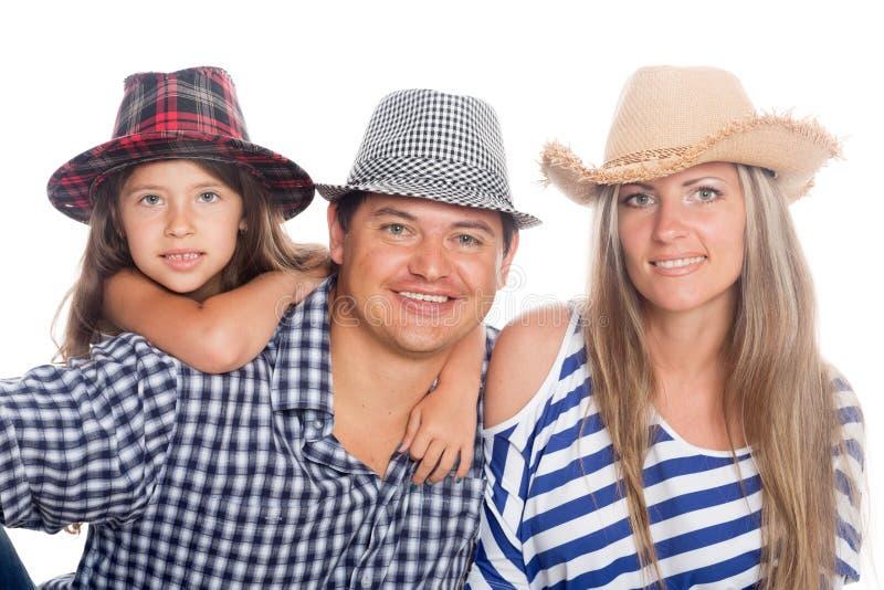 Szczęśliwa rodzina w kapeluszach zdjęcie stock