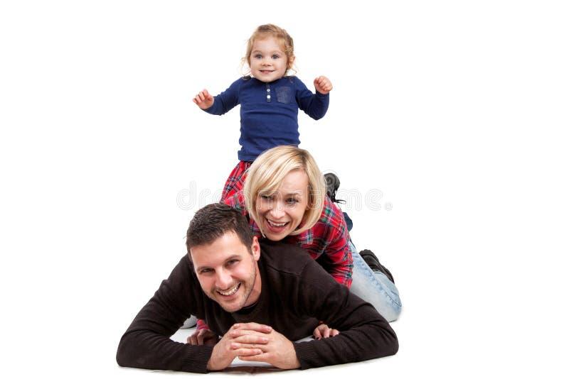 Szczęśliwa rodzina z małą córką zdjęcia royalty free