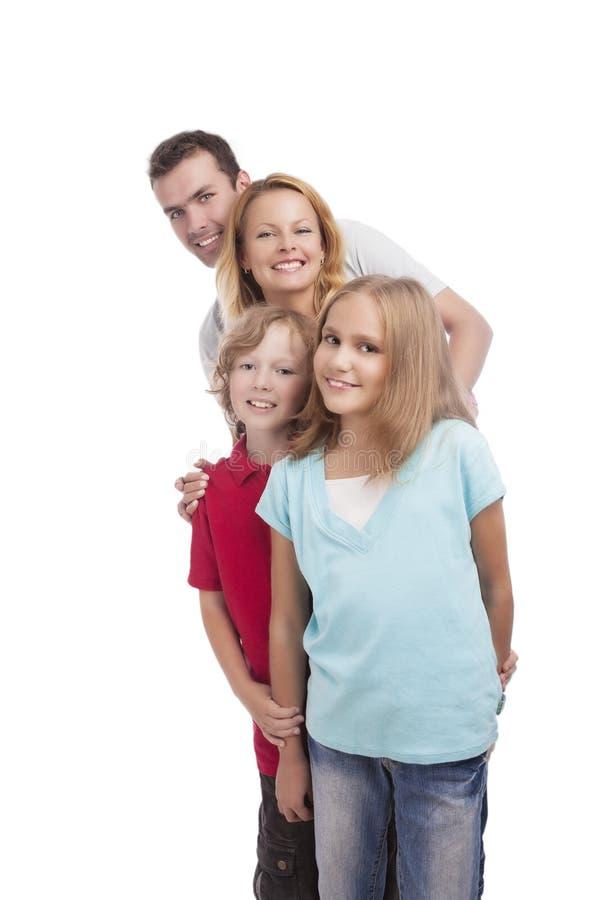 Szczęśliwa rodzinna pozycja w queu. pionowo krótkopęd obraz stock