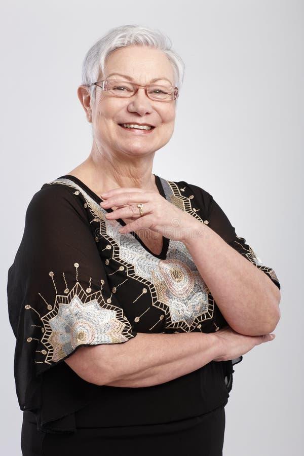Szczęśliwa stara kobieta w wieczór sukni zdjęcie royalty free