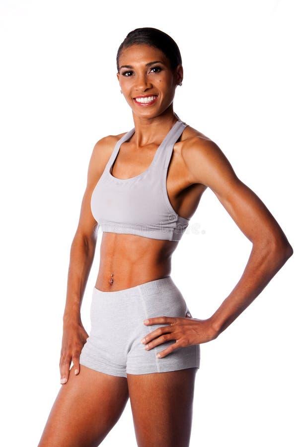 Szczęśliwa uśmiechnięta żeńska atleta zdjęcie royalty free