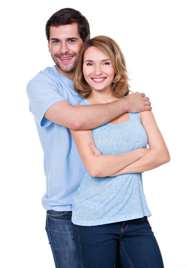 Szczęśliwa uśmiechnięta para stoi wpólnie obraz stock
