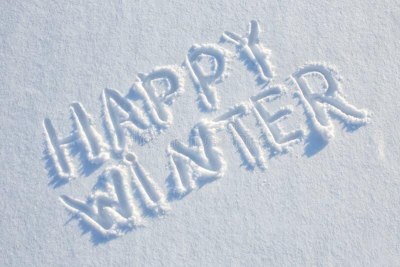 Szczęśliwa zima pisać na śniegu zdjęcie royalty free