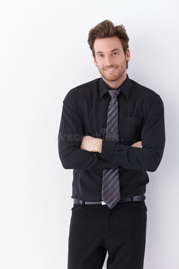 Szczęśliwe biznesmen pozyci ręki krzyżować zdjęcie stock