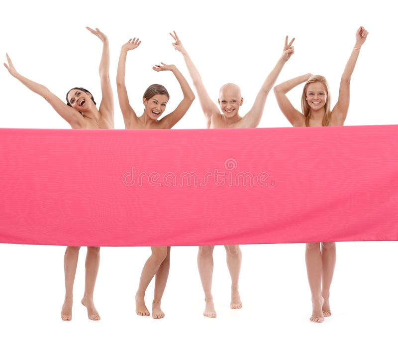 Szczęśliwe kobiety w menchiach - nowotwór piersi Awereness obraz stock