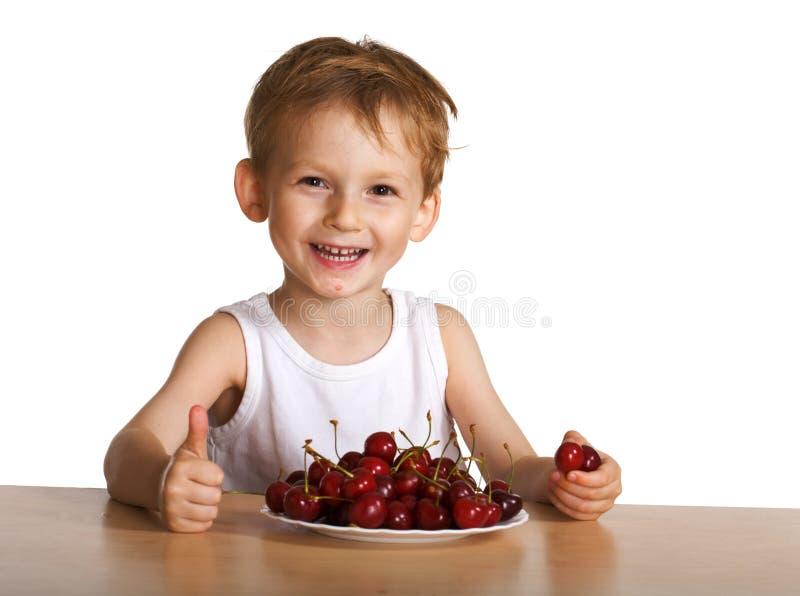 szczęśliwego dziecka wiśniowy fotografia stock