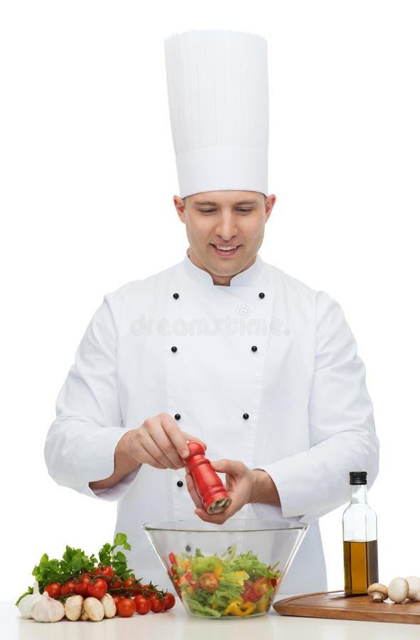 Szczęśliwego męskiego szefa kuchni kucharza kulinarny jedzenie obrazy stock