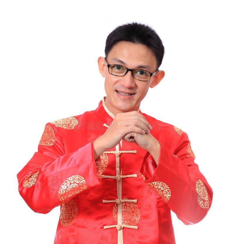 szczęśliwego nowego roku chiński Młody Azjatycki mężczyzna z gestem congratul zdjęcie stock