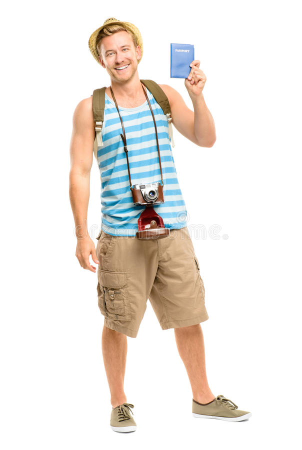 Szczęśliwego turystycznego mienia paszportowa retro kamera odizolowywająca na bielu zdjęcie stock