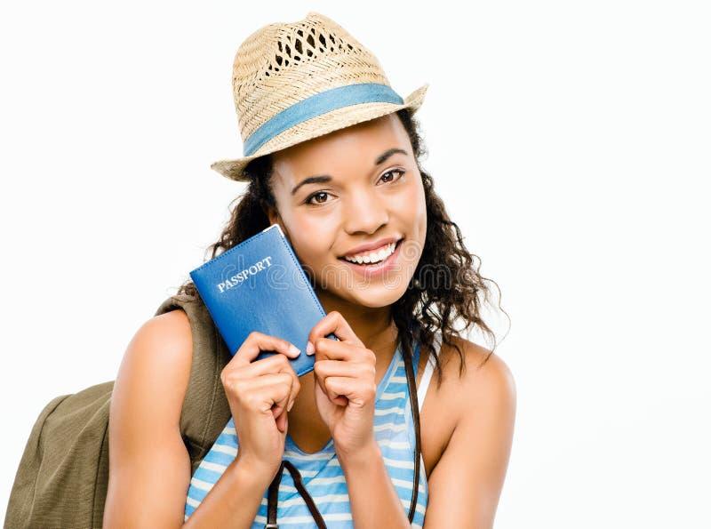 Szczęśliwej kobiety mienia turystyczny paszport zdjęcie royalty free