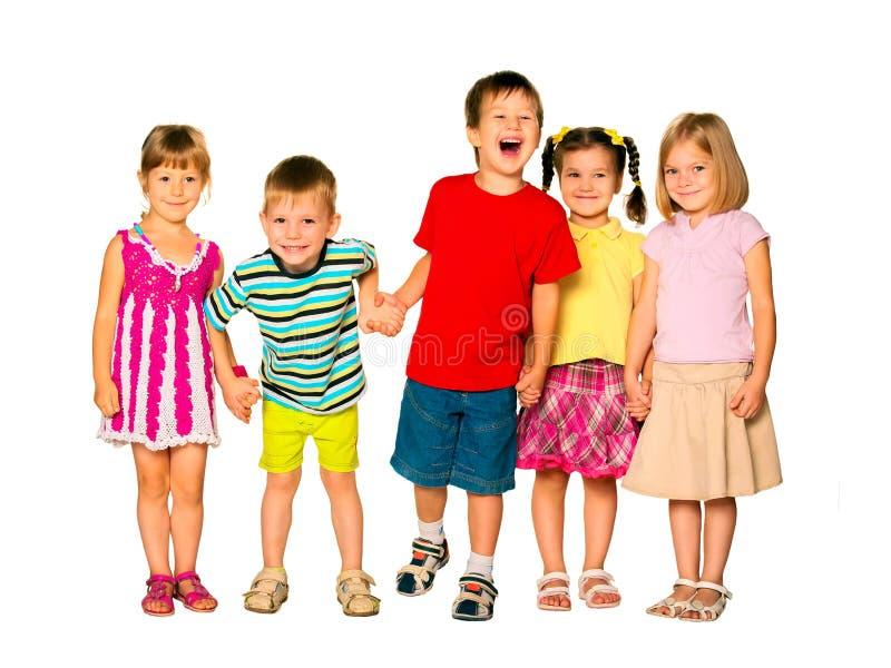 Szczęśliwi śmia się dzieciaki trzyma ręki zdjęcie royalty free