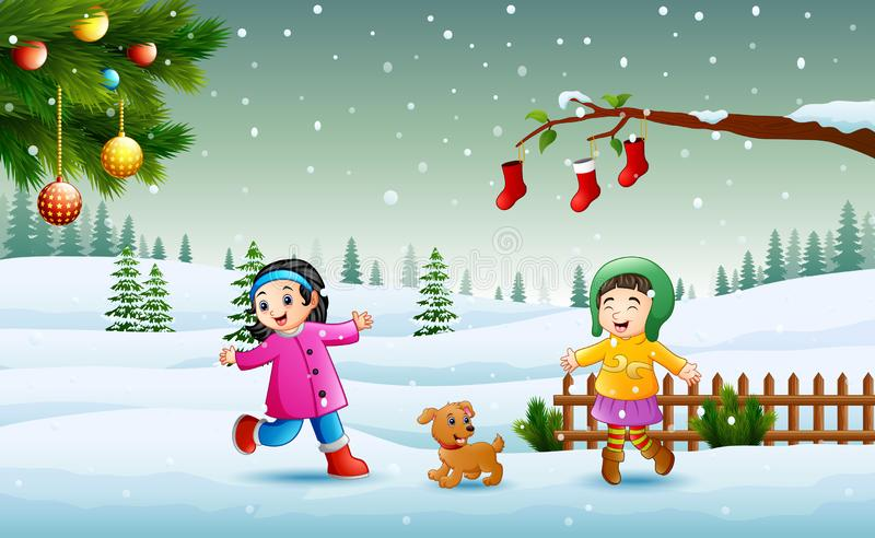 Szczęśliwi dzieciaki jest ubranym zimy chlotes bawić się na śniegu w święto bożęgo narodzenia royalty ilustracja