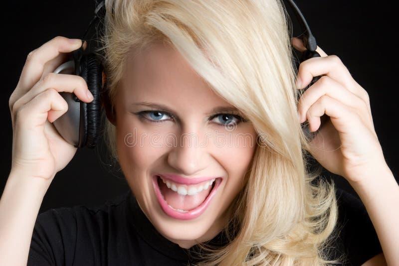 szczęśliwi dziewczyna hełmofony zdjęcie stock