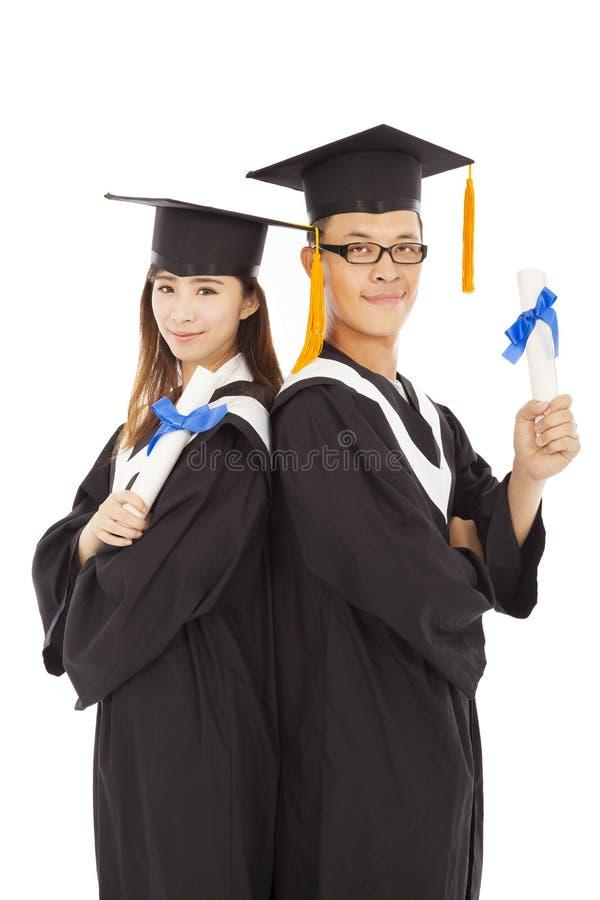 Szczęśliwi kończy studia ucznie odizolowywający na bielu zdjęcia stock