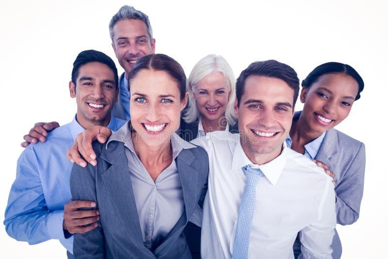 Szczęśliwi ludzie biznesu patrzeje kamerę obraz stock