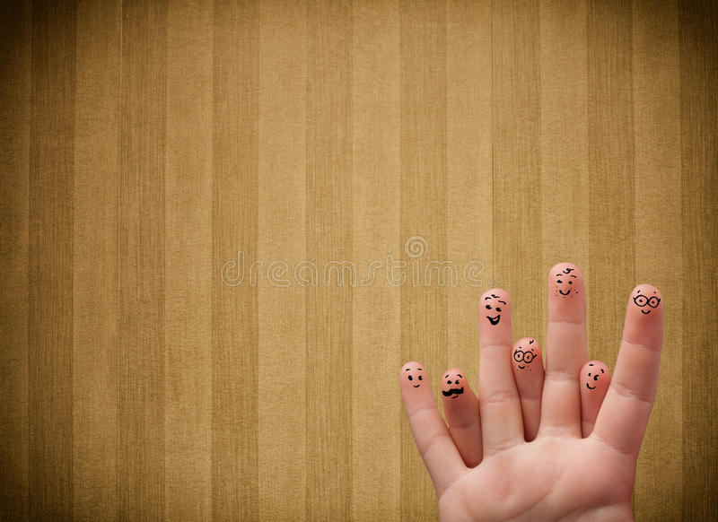 Szczęśliwi palcowi smileys z rocznikiem paskują tapetowego tło fotografia stock