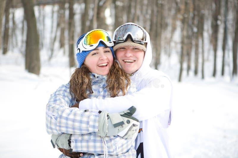 szczęśliwi par snowboarders zdjęcie royalty free