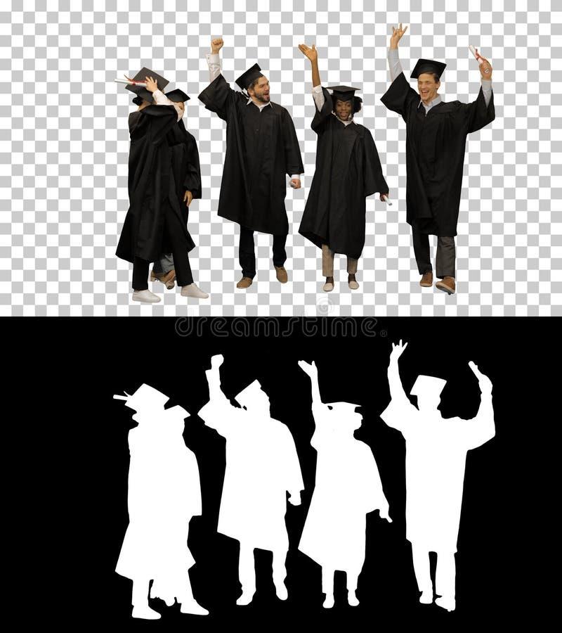 Szczęśliwi przyjaciele absolwenci łączą ręce fotografia royalty free