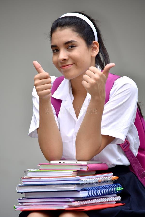 Szczęśliwy Śliczny Kolumbijski dziewczyna uczeń Jest ubranym mundur Z podręcznikami zdjęcia stock