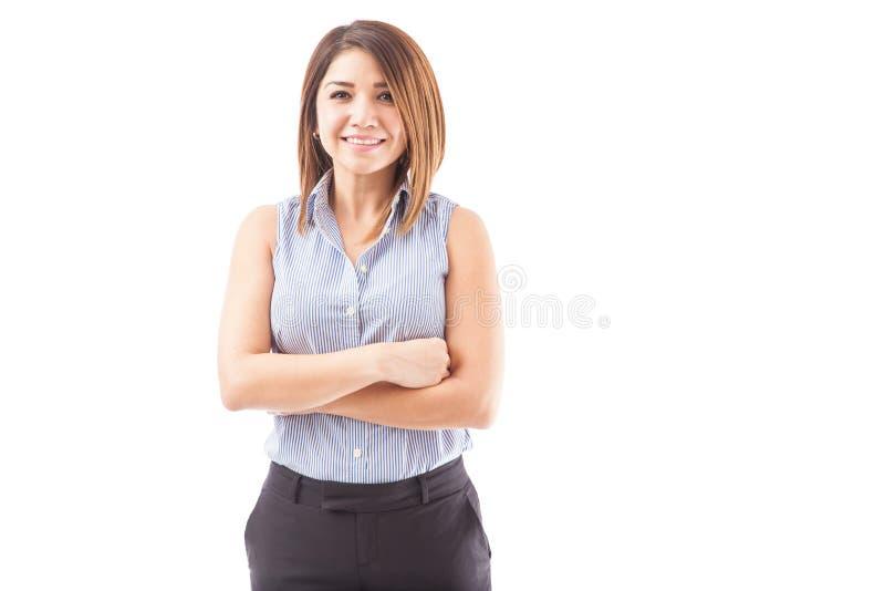 Szczęśliwy żeński nauczyciel z rękami krzyżować fotografia stock