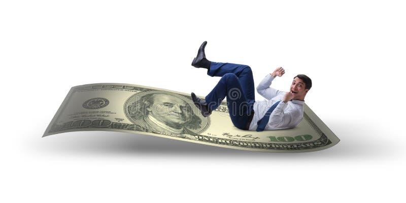 Szczęśliwy biznesmen na dolarowym banknocie odizolowywającym na białym backgroun obrazy stock
