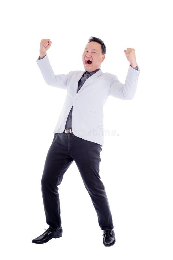 Szczęśliwy biznesmen w białym kostiumu nad bielem zdjęcie stock