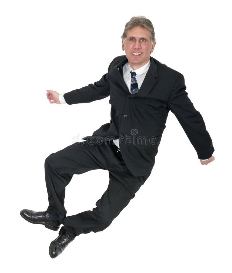 Szczęśliwy biznesmen Z uśmiechów skokami, stuknięcie pięty Odizolowywać zdjęcia stock
