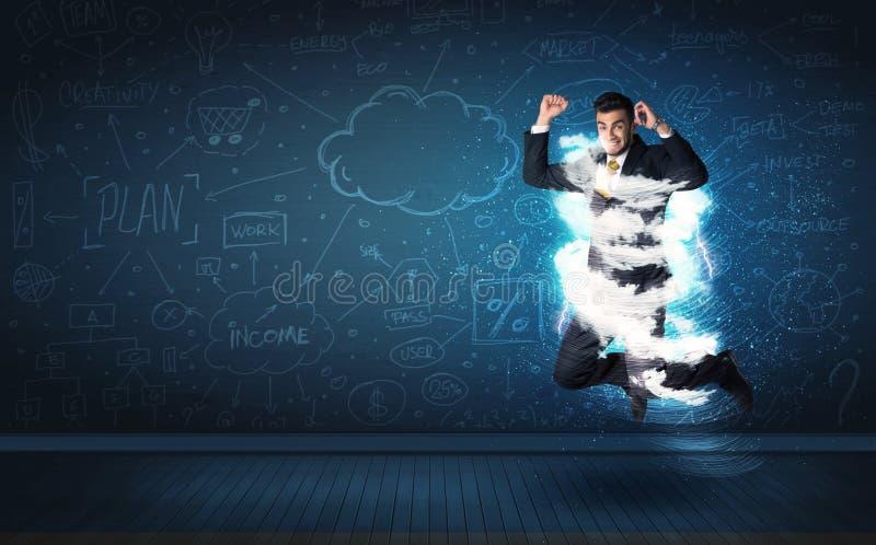 Szczęśliwy biznesowego mężczyzna doskakiwanie z burzy chmurą wokoło on zdjęcie stock