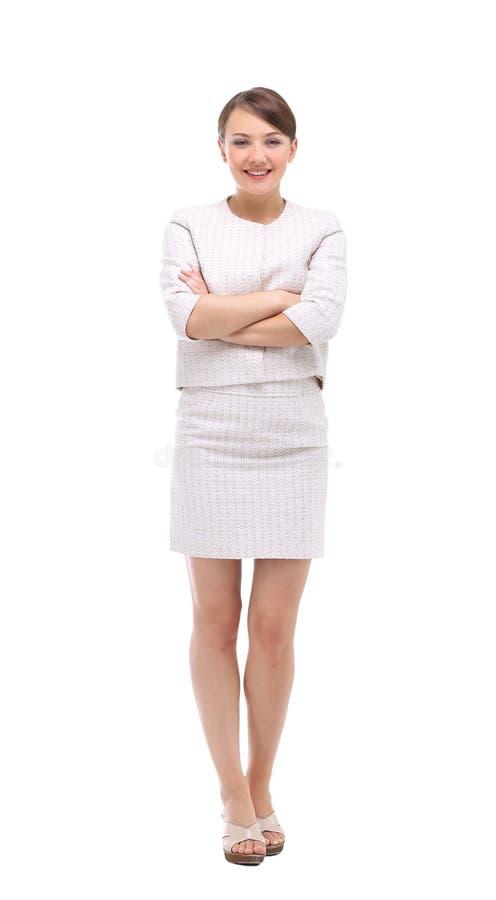Szczęśliwy bizneswoman jest ubranym beżową kostium pozycję i falcowanie ręki obrazy royalty free