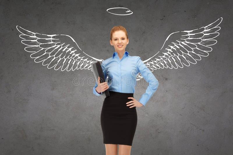 Szczęśliwy bizneswoman z anioła nimbem i skrzydłami zdjęcia royalty free